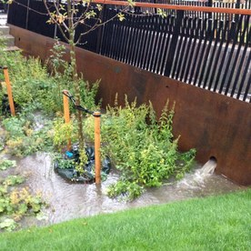 Stormwater detention area on Tåsinge Plads under a cloudburst